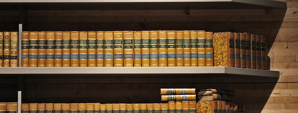 rows of leather bound books