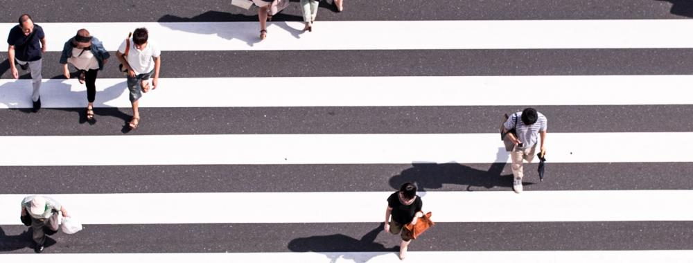 overhead shot of people in a pedestrian crossing