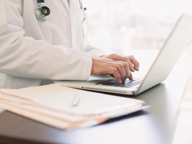 medical professional using laptop